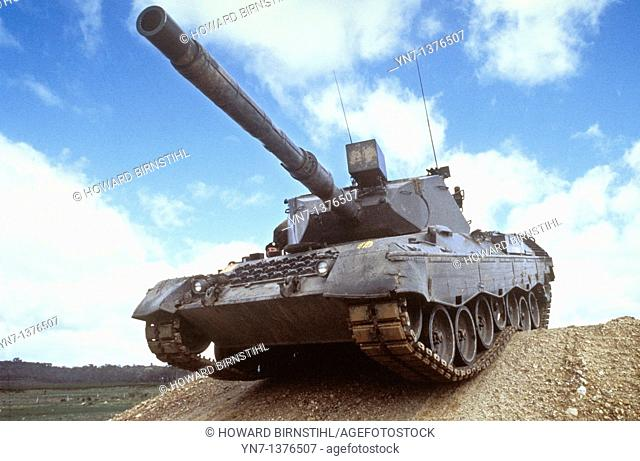 M1A army tank crossing the crest of a hill