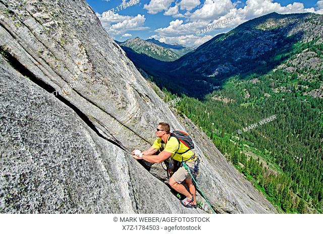 Rock climbing a route called the Regular Route which is rated 5, 6 and located on Slick Rock near the city of McCall in the Salmon River Mountains of central...