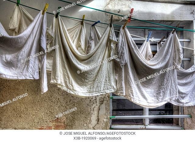 Wash linens in a courtyard of Madrid, Spain