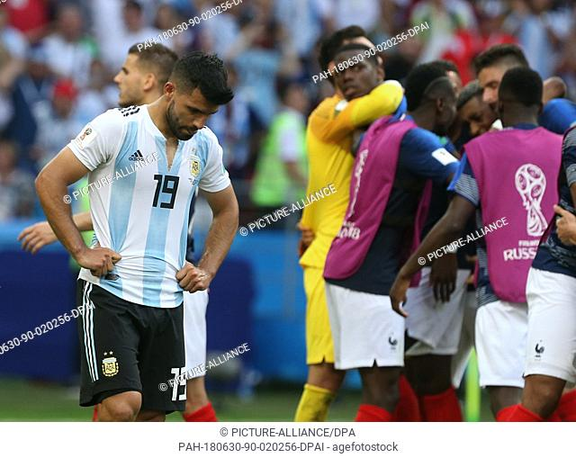 30 June 2018, Russia, Kazan: Football World Cup, France vs Argentina at the Kazan Arena. Sergio Agüero (l) of Argentina reacts after the match