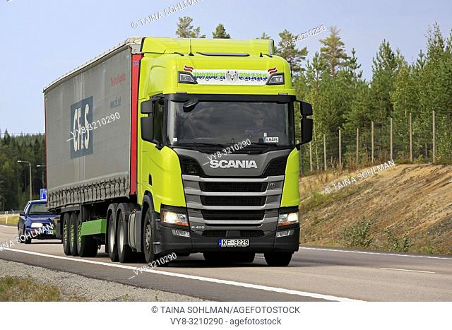Vaajakoski, Finland - August 24, 2018: Neon Next Generation Scania R450 freight truck of Power Trans pulls curtainside trailer along highway 4 on a beautiful...