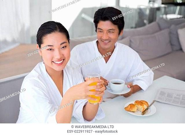 Couple in bathrobes spending the morning together