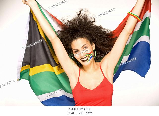 Young woman holding South African flag