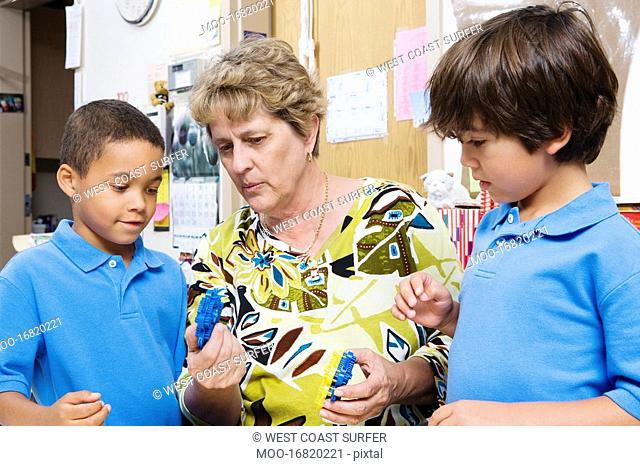 Teacher Talking with Elementary Students
