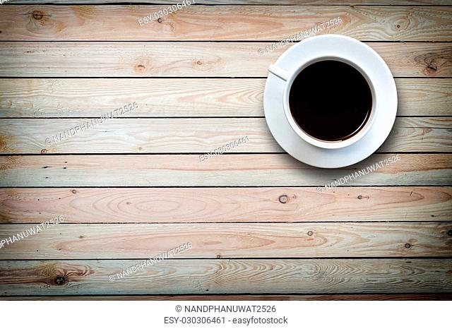 Close up white coffee cup on wooden table top view