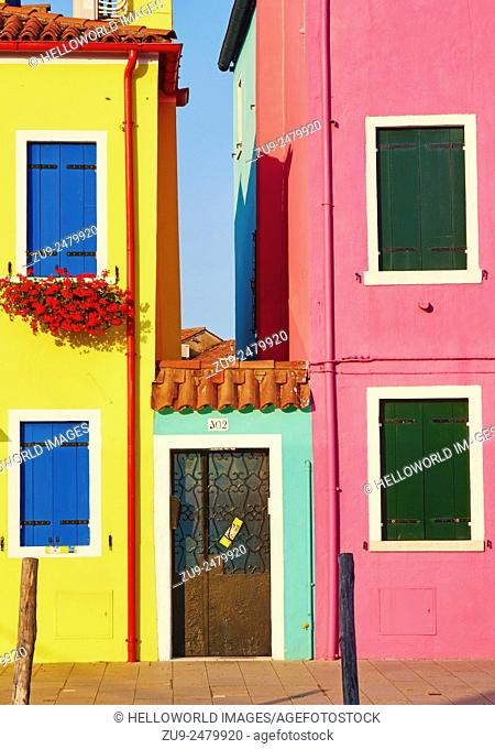 Entrance between two colourful houses, Burano, Venetian Lagoon, Veneto, Italy, Europe