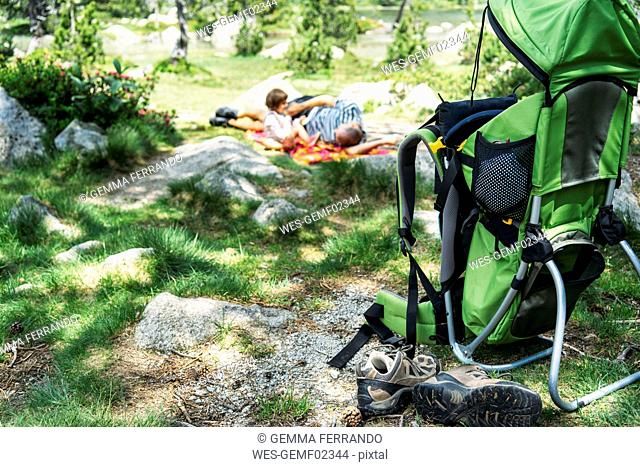 Spain, Father and daughter lying on a blanket, resting in nature