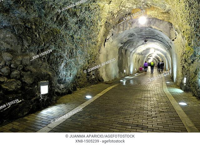 People walking inside the tunnel of the watchtower in Laredo, Cantabria, Spain