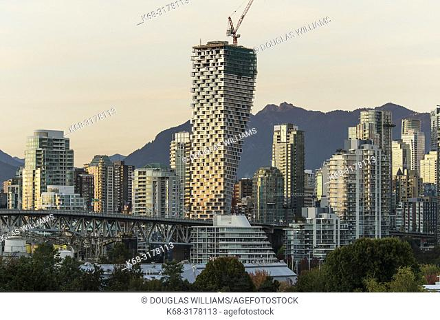 Skyline of downtown, at twilight, with Vancouver House tower in centre, Vancouver, BC, Canada