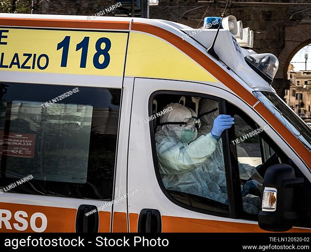 118 health workers in an ambulance with overalls, goggles, gloves and protective mask in Piazza di Porta Maggiore , ITALY-12-05-2020