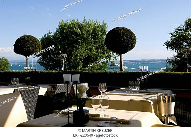 Tables are laid at the terrace with view of the lake at Restaurant Casala, Hotel Residenz am See, Meersburg, Lake Constance, Baden-Wurttemberg, Germany
