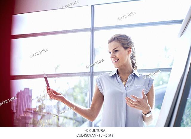 Young woman conducting training presentation