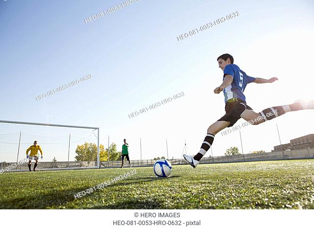 Soccer player ready to kick soccer ball