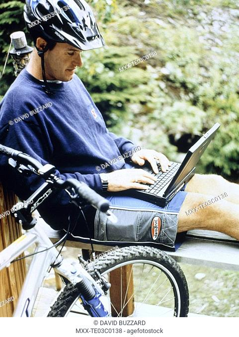 Moutain biker with laptop computer