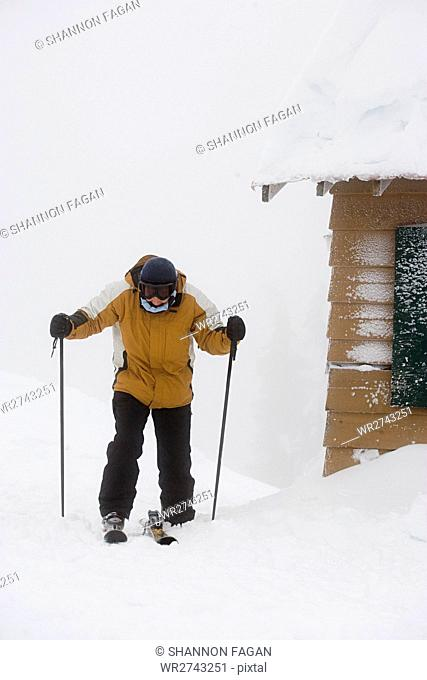 Skier by cabin