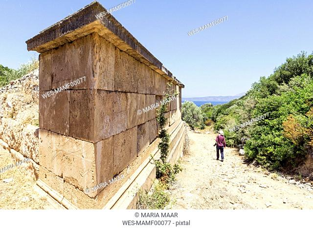 Greece, Attica, ancient city Rhamnous, old grave and tourist