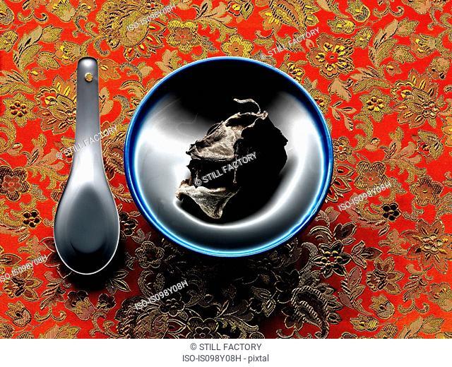 Mu Err mushroom in bowl with spoon