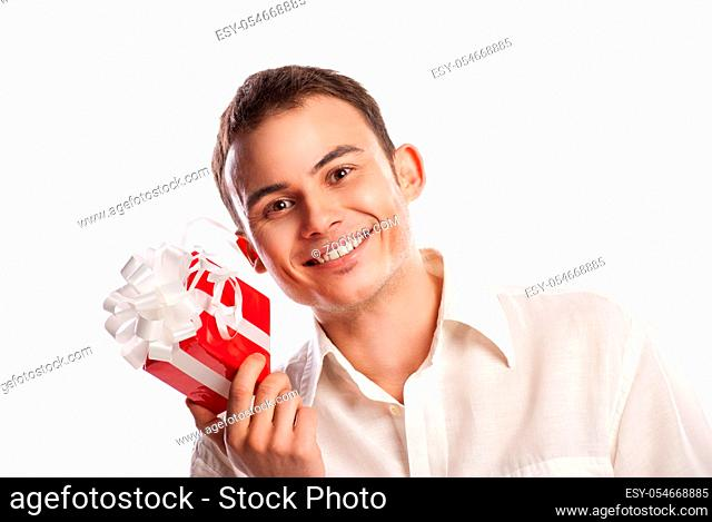 Close-up portrait of smiling man holding gift isolated on white background