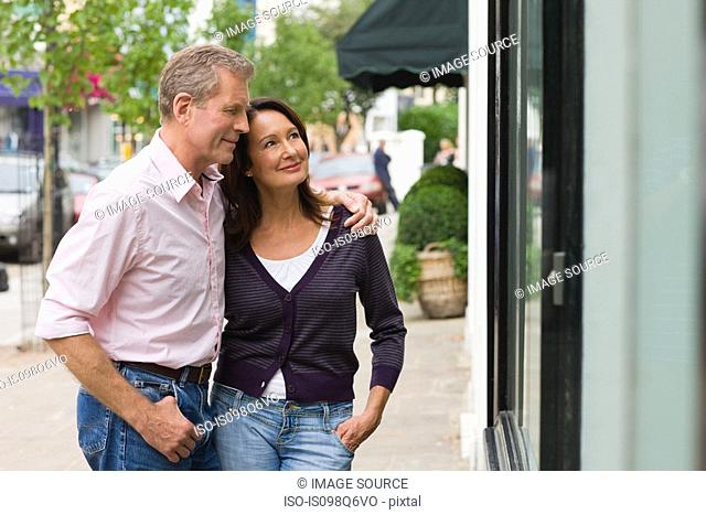 A couple looking in a shop window