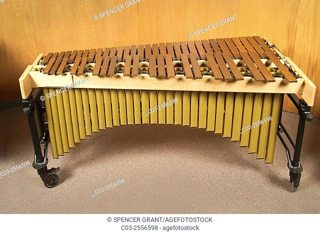 The marimba is a percussion instrument consisting of a set of wooden bars struck with mallets to produce musical tones. It is a type of idiophone,