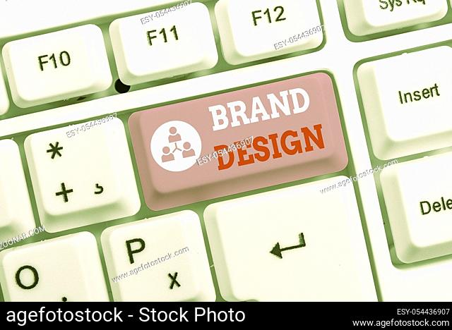 Conceptual hand writing showing Brand Design. Concept meaning visual elements that make up the corporate or brand identity White pc keyboard with note paper...