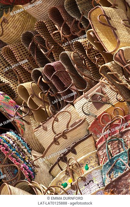 Collection of woven bags and baskets with colourful embroidery are for sale in the souks in the old Medina