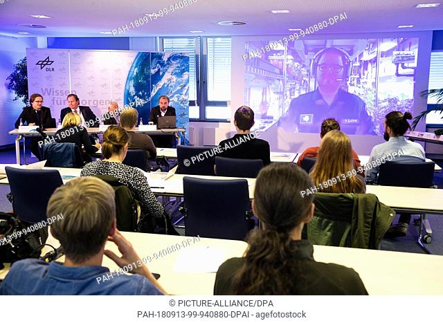 13 September 2018, Bremen: Researchers and journalists sit in a room at the press conference on the Antarctic greenhouse stand and listen to space engineer Paul...