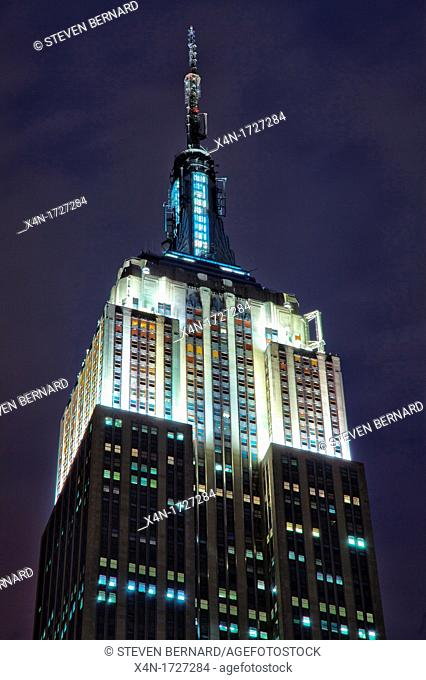 Detail of the Empire State Building at night on Fifth Avenue in Manhattan, New York City, United States of America