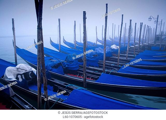 Gondolas in the fog, Venice, Italy