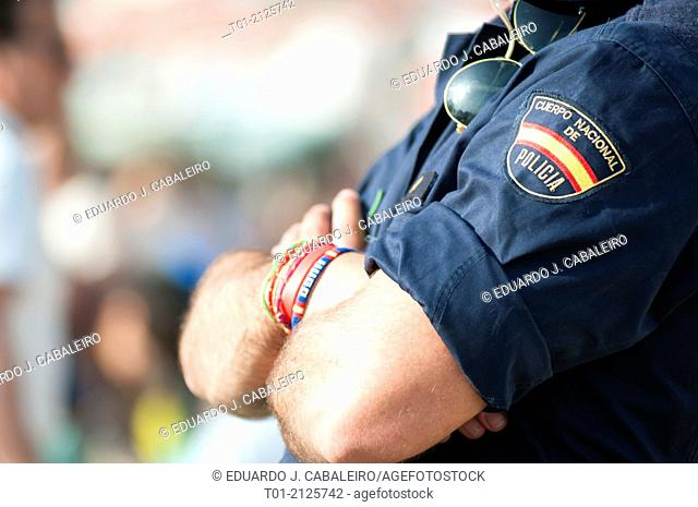 Police detail with bracelets, sunglasses and arms crossed