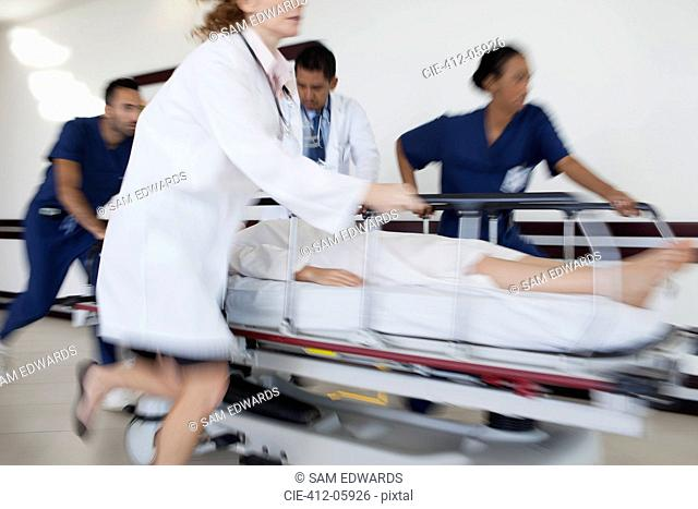 Hospital staff rushing patient to operating room