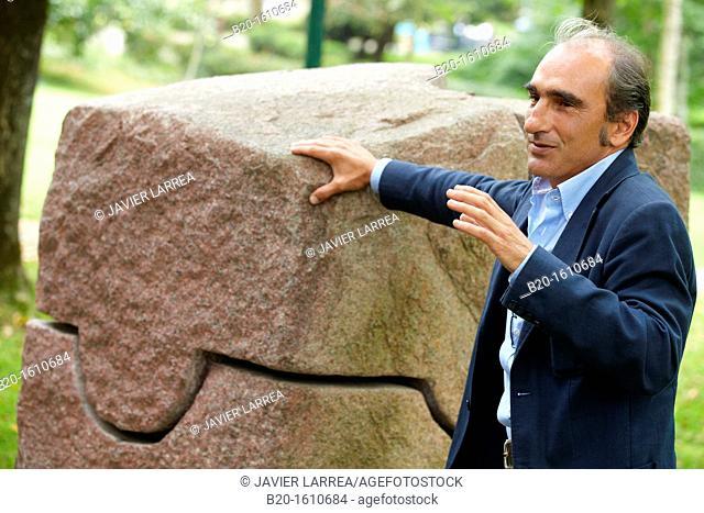 Luis Chillida explaining the sculpture of his father Eduardo Chillida, Chillida Leku Museum, Hernani, Near of Donostia, San Sebastian, Gipuzkoa, Basque Country