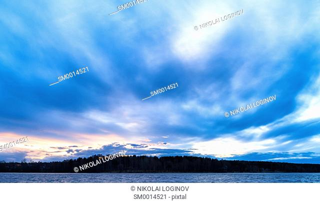 Horizontal vivid ocean cloudscape horizon land