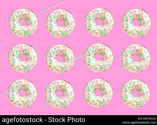 Pattern made of ring donuts with white glaze and clourful hundreds and thousands on pink background