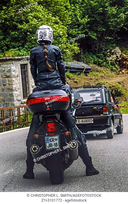 Motorcyclist riding the roads up through the Austrian Alps in Europe during the summertime