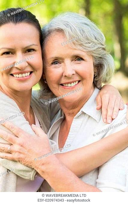 Smiling mature woman with adult daughter