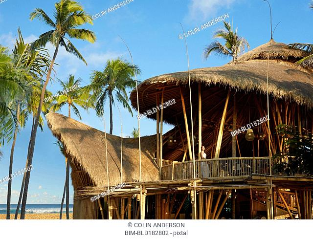 Pacific Islander woman standing on balcony