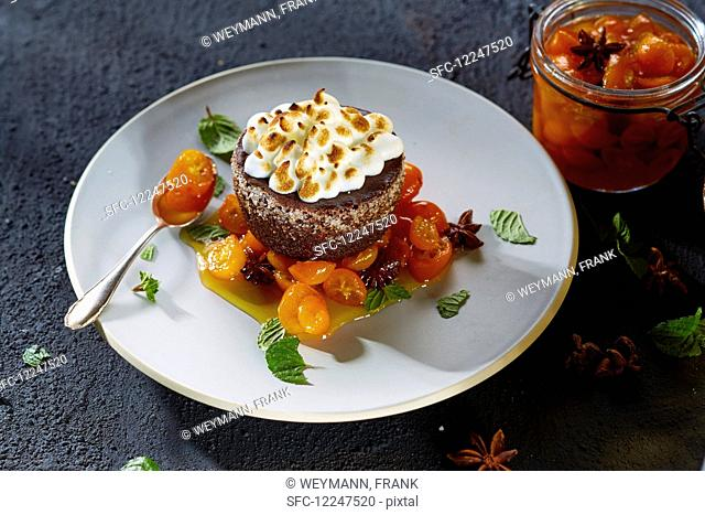 Chocolate cake with meringue and candied kumquats