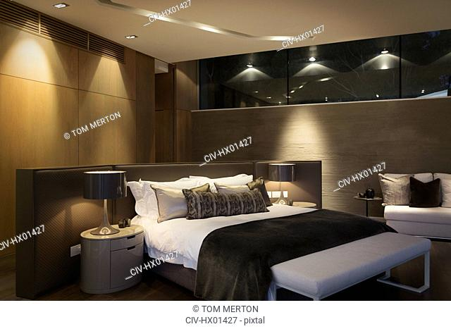 Illuminated home showcase bedroom at night