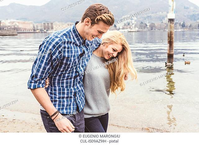 Young couple strolling on lakeside, Lake Como, Italy