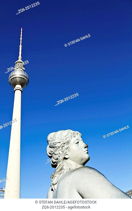 Statue of the Neptun Fountain and TV Tower on Alexanderplatz in Berlin, Germany