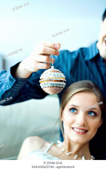 couple with glass ball at home