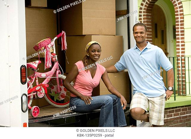 Young couple near a moving truck