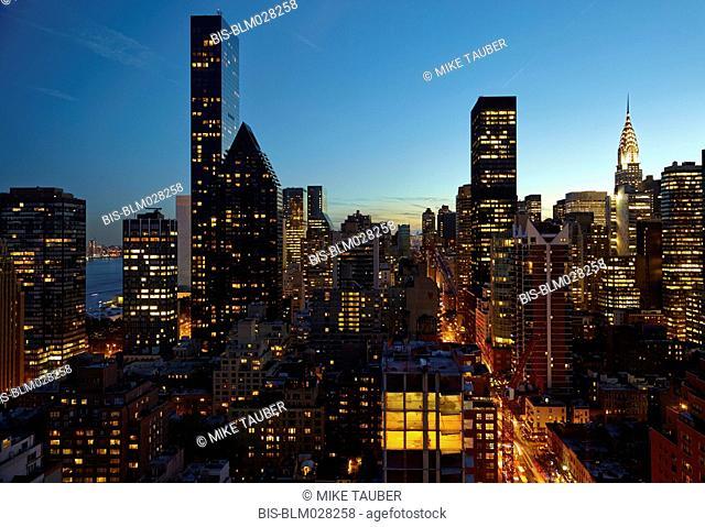 Skyline lit up at night, New York, New York, United States