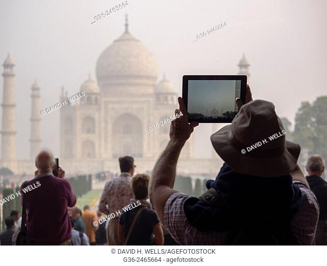 Person photographing Taj Mahal using mobile camera, Agra, Uttar Pradesh, India
