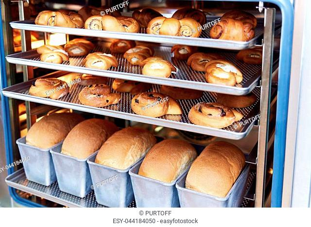 Dessert bread baking in Combi steamer. Production oven at the bakery. Baking bread