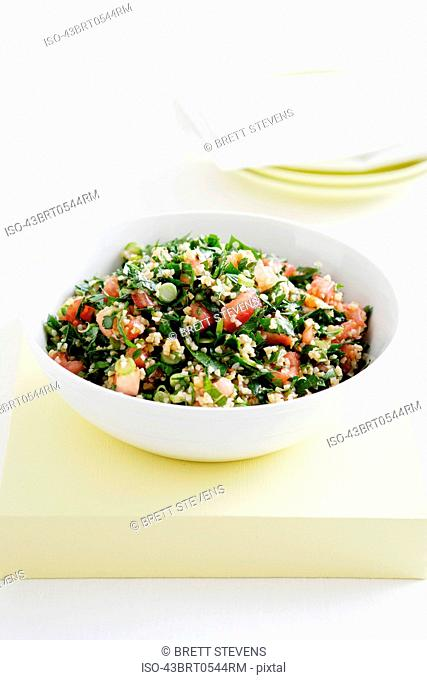Bowl of tabouli with herbs and tomatoes