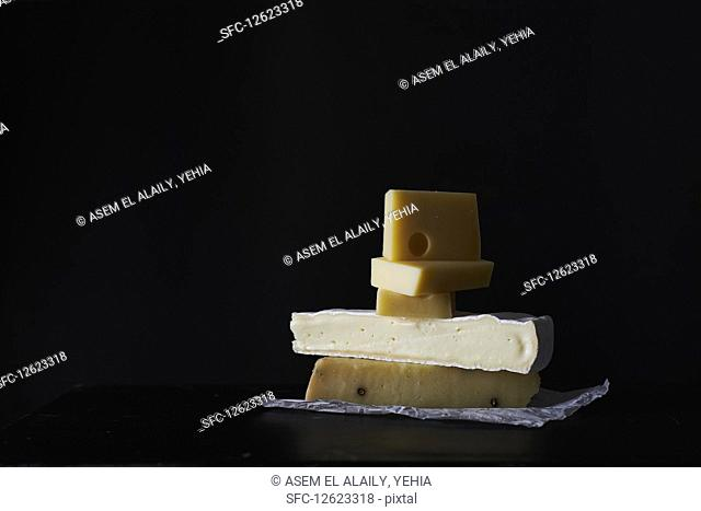 A stack of various cheeses
