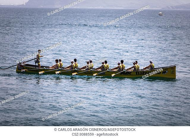 CASTRO URDIALES, SPAIN - JULY 15, 2018: Competition of boats, regata of trainera, Orio Babyauto boat in action in the VI Bandera CaixaBank competition