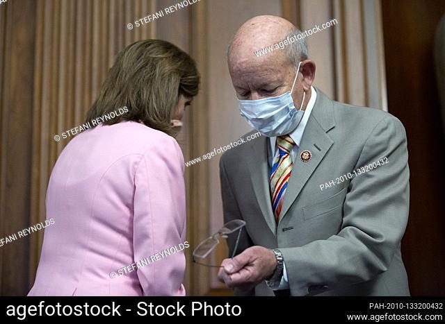 Speaker of the United States House of Representatives Nancy Pelosi (Democrat of California) speaks to United States Representative Peter DeFazio (Democrat of...